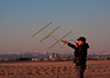 Tent Pole Special<br /> <br /> Sunrise finds me making a contact with my new handheld yagi, as the sun rises on the city of Calgary and the southern Alberta Rockies to the west. <br /> <br /> <br /> Some years back, I built a handheld 3 element yagi to use with my handitalki. The antenna was a superb performer, allowing me to work repeaters in the Calgary area, from as far away as the Upper Kananaskis lake in Kananaskis country, a distance of 85 miles to the west of me in this photo. After some time, I sold this cute little yagi to a fellow ham, as I did not like the fact that it proved to be slow to assemble and take down. I meant to build another yagi with improvements, but never got around to it till now.<br /> <br /> Lately I decided that it was time to build a new handheld yagi for my HT, and after spending some time deciding how I would make a better mousetrap out of the original handheld yagi that I had built several years back, I then made a trip down to the Mountain Equipment Co-op. At one time or another, while in MEC, I had seen replacement sections of high tensile anodized aluminum, used for repairing damaged sections of tent pole assemblies.  These replacement segments are made by Easton from 7075 T6 high tensile Aluminum alloy, and therefore are a very good choice of material for building antennas.<br /> <br /> <br /> My original yagi had 6.5db of forward gain, and a front to back ratio exceeding 25db. I expect this yagi to have similar performance.<br /> <br /> One of the differences with this yagi, is the gamma match method that I have designed for this yagi. The following photos show the construction of my tent pole special.