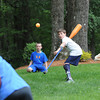 Kane Goodman prepares to hit the ball while playing with friends in his backyard.<br /> Photo by Paul Bilodeau