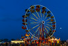 The Wonder Shows midway and ferriswheel illuminated at night in Winkler, Manitoba, Canada.