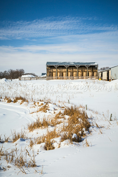 A hay storage building overlooking a snowy valley near Morden, Manitoba, Canada.