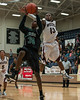 #34 Isaak Rowe attempts a lay up, but #13 Tyus Momoh knocks it away.  (Courtesy of Rodney Rodgers)