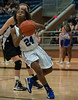 Summit's #24 Nia Jackson drives for a lay up.  (Courtesy of Rodney Rodgers)