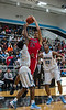 #21 Trey Edwards goes up and over #22 G. Wesley for two.  (Courtesy of Rodney Rodgers)