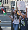 Young gilr with Palestinian flag and young boy, at demonstration in Denver.