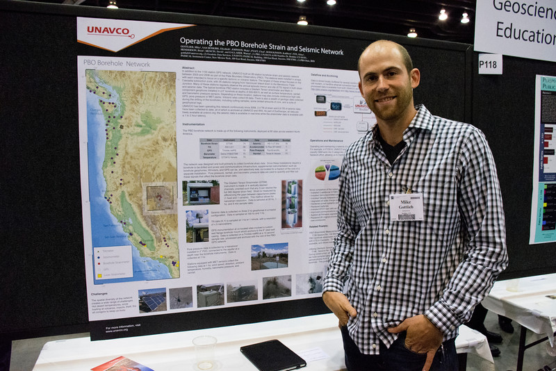UNAVCO borehole manager Mike Gottlieb at his poster at the 2014 annual GSA meeting in Vancouver, B.C. (Photo/Beth Bartel)