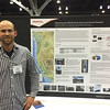 UNAVCO borehole manager Mike Gottliebe at his poster at the 2014 annual GSA meeting in Vancouver, B.C. (Photo/Aisha Morris)