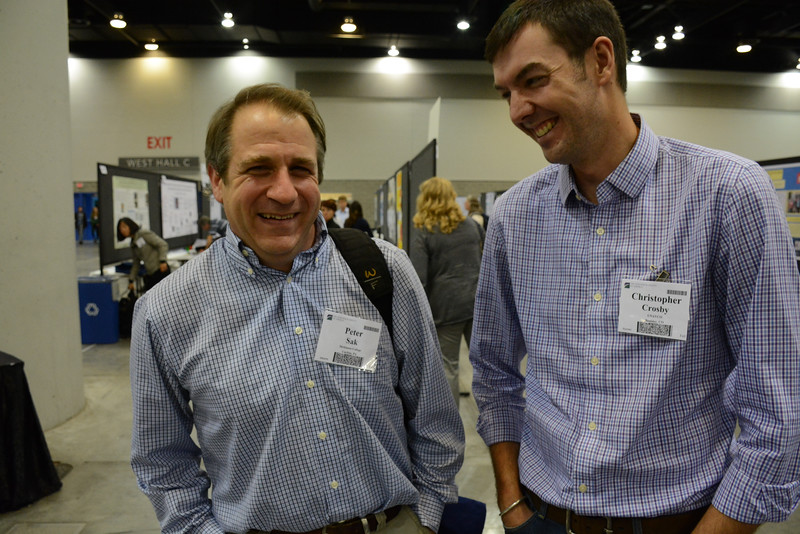 UNAVCO TLS project manager Christopher Crosby (right) with fellow Whitman alumnus Peter Sak at the 2014 annual GSA meeting in Vancouver, B.C. (Photo/Beth Bartel)