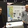 UNAVCO borehole manager Mike Gottlieb )right) with Ken Austin at his poster at the 2014 annual GSA meeting in Vancouver, B.C. (Photo/Beth Bartel)