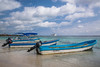 Fishing boats on the beach at the village of Mahahual, Mexico,