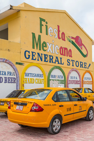 Yellow taxis at the General Store in the village of Mahahual, Mexico.
