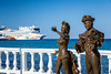 Decorative sculptures along the malecon with Norwegian cruise ships in the port of Cozumel, Mexico.