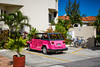 Spanish architecture and a pink car in Cozumel, Mexico.