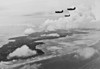 Three U.S. Helldiver bombers over Yap on July 26, 1944 (U.S. Navy photograph)