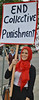 Young Muslim woman smiling, marching in Palestinian protest holding sign about collective punishment.