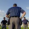 Home plate umpire Mike Neubeck, center, addresses his crew prior to the start of a Saints exhibition game on May 17, 2003.  (Pioneer Press: Richard Marshall)