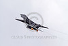 F-14USN-VF-101 0016 A Grumman F-14 Tomcat USN jet fighter zooms up in burner with wing tip vortex military airplane picture by Peter J Mancus