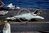 F-14USN-VF-84 0017 A Grumman F-14 Tomcat USN VF-84 THE JOLLY ROGERS is towed on an aircraft carrier 1-1990 military airplane picture by Rick Morgan