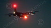 WWAN 00050 A Lockheed C-130 Hercules USAF cargo airplane landing at night with flashing red strobe lights military airplane picture by Peter J Mancus