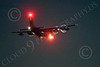 WWAN 00020 A Lockheed C-130 Hercules USAF cargo airplane landing at night with flashing red strobe lights military airplane picture by Peter J Mancus