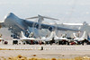 C-5USAF 0062 A Lockheed C-5 Galaxy USAF heavy lift cargo jet easily dwarfs F-16 jet fighters at Nellis AFB military airplane picture by Peter J Mancus