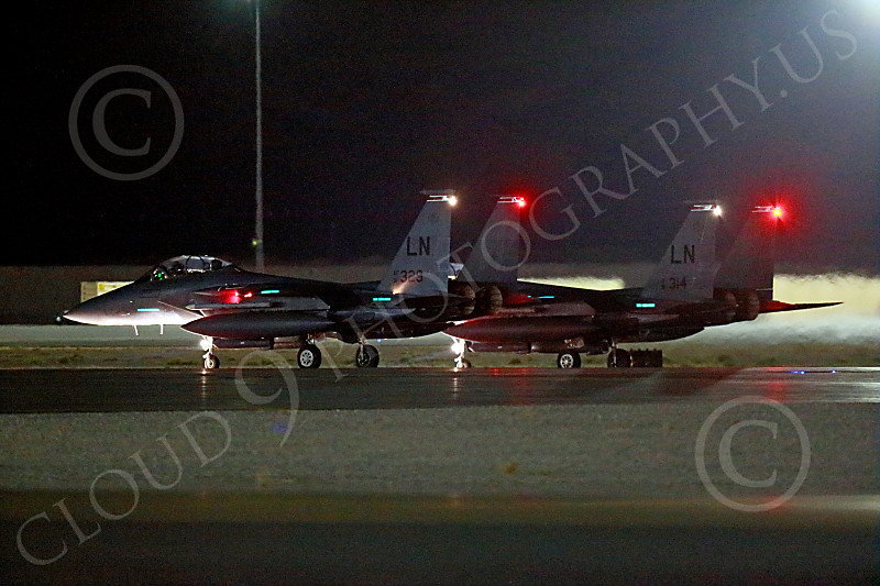 F-15USAF 00841 Two LN code USAF McDonnell Douglas F-15E Strike Eagles taxis for a night Red Flag mission at Nellis AFB 7-2014 military airplane picture by Peter J Mancus