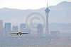 B-1USAF 00042 A Rockwell B-1B Lancer USAF jet bomber lands at Nellis AFB with Las Vegas in the background military airplane picture by Peter J Mancus