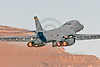 AB-B-1USAF 00094 A USAF Rockwell B-1B Lancer strategic jet bomber 37BS 86094 EL code takes off at Nellis AFB in full afterburner military airplane picture by Peter J Mancus