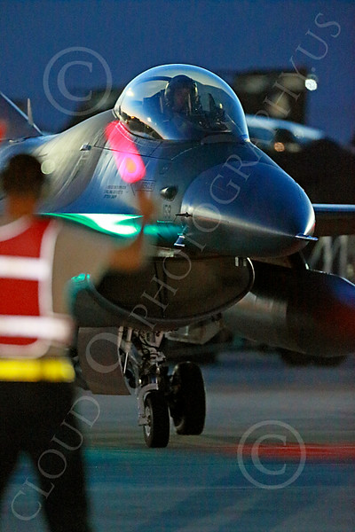 ACM 00225 A USAF F-16 Viper fighter pilot is guided into position for a safety check before a night Red Flag mission at Nellis AFB 7-2014 military airplane picture by Peter J Mancus