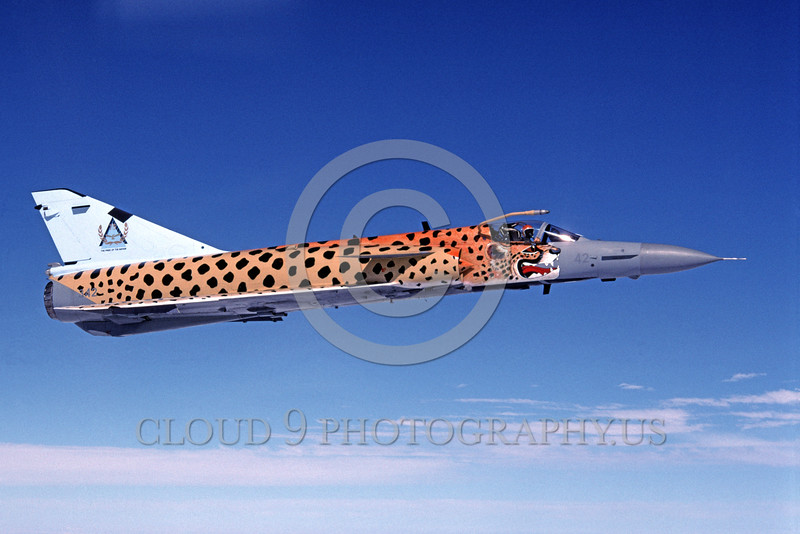 EE-Kfir 00002 A colorful flying Israeli Aircraft Industries Kfir South African Air Force jet fighter with cheetach paint scheme military airplane picture 6-1995 via African Aviation Slide Service