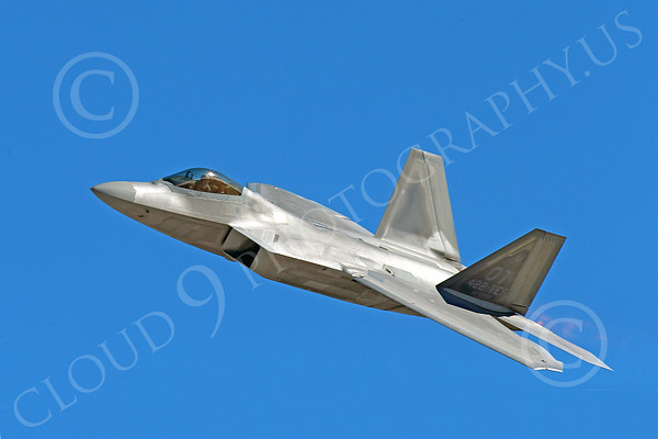 F-22USAF 00564 A USAF Lockheed Martin F-22 Raptor air superiority steatlh jet fighter OT code in afterburner screams toward its target military airplane picture by Peter J Mancus