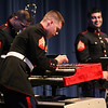 The U.S. Marine Corps Jazz Ensemble performs at UMass Lowell. Sergeant Devin Penner on keyboard, Staff Sergeant Ken Ebo on trombone, left, and Sergeant Charlie Arbelaez on alto sax, right. (SUN/Julia Malakie)