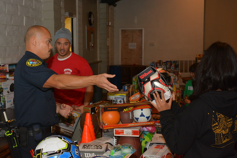 Milpitas Firefighters/Food Pantry distribution 12-20-14. Fire Fighter Zamora
