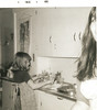 1966_12; colleen hatfield & loretta miles baking cookies at the johnsons house; lincoln city, oregon