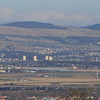 Glasgow Airport as seen from Glennifer Braes, with an EasyJet flight taking off.