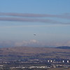 Glasgow Airport as seen from Glennifer Braes, with a British Airways flight taking off.