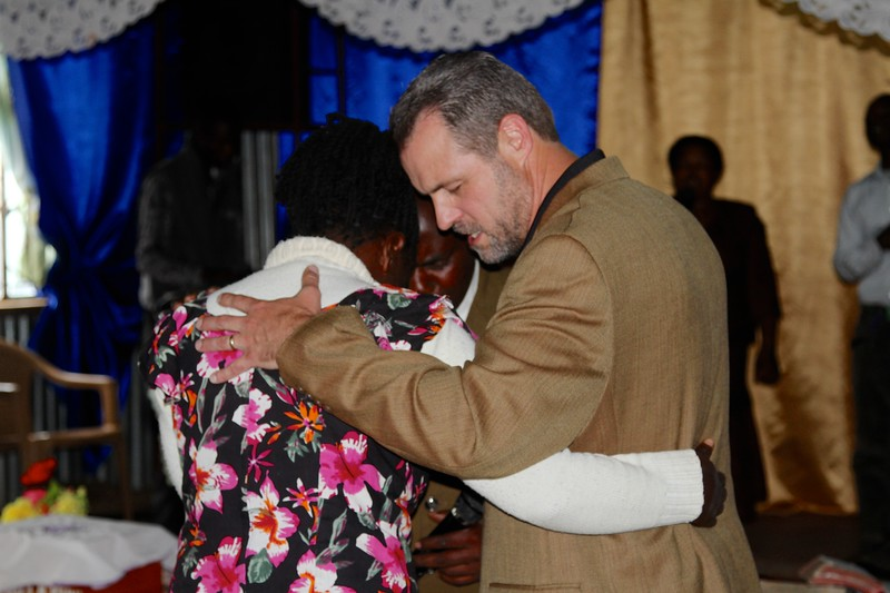 Praying with Pastor Francis' wife, Grace