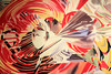 "closeup of part of a large lithograph by James Rosenquist, ""The Stowaway Peers Out at the Speed of Light""."