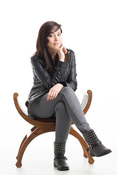 Young Female Posing in Leather Jacket on Chair  Available Royalty Free at Shutterstock  Follow me on: Facebook | Twitter | Flickr | Pinterest | Model Mayhem