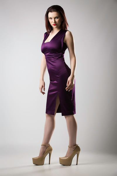 Kat Posing in Purple Dress