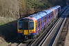 29th Nov 06:  Nearly new 450115 trundles up the slow line
