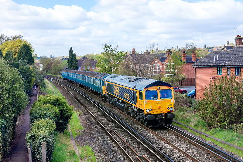 29th Apr 13:  With the sun still a couple of minutes away 66738 potters through Egham working 5Z17 to return   4VEP 3417 to Clapham after appearing at the Mid Hants Diesel Gala