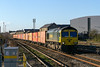19th Dec 14:  4L31 from Bristol Freightliner Terminal to Tilbury hurries through Swindon  powered by 66954