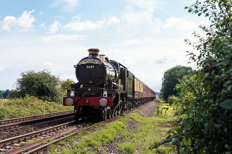 27th Jul 14:  Running over the site of Fairwood Troughs is 5029 'Nunney Castle' fronting the 'Weymouth Seaside Express' from Bristol to Weymouth