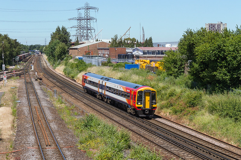 30th Jun 2015:  In the immaculate condidtion typical of Salisbury Depot units 158888 is working 2R42 the 11.56 Salisbury to Romsey via Southampton.  Redbridge Station can just be seen in the distance.