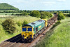 7th Jun 2015:  A very welcome unusual working  on the Wylye Valley route is Freightliner operated 6Z97 from Eastleigh to Ystrad Mynach South.  66602 is providing the urge as it passes Arn Hill and starts the drop down to Westbury