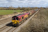 26th Mar 2015:  Passing Coedkernew is 66055 with covered steel wagons working as 6B09 the 09.27 Newport Docks to Margam-TC