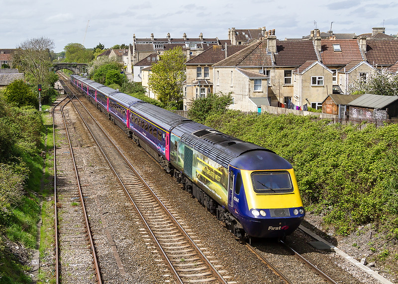 4th May 2015: With Bath's Oldfield Park station in the background  'Building a Greater West' branded power car 43144 leads on 1A17 the 12.30 from Bristol Temple Meads to Paddington