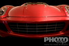 Low front view of red Ferrari, front  view, hood, windscreen and grille