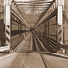 """B grade Set Subject/Lead In Lines........""""Taramakau River Bridge"""" by Anne Macdonald........Accepted<br /> <br /> Another good example of lead in lines so brownie points here for SO MANY lead in points. I like the use of the sepia but I would have had it slightly darker and the use of selective colour to highlight the car would have really help push this image further. Accepted but had potential to be a merit"""