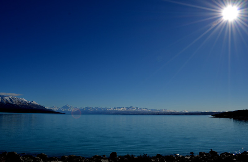 Pukaki  -  Bridget Jones A beautifully composed image, The horizon on the third and just enough rocks in the foreground to give us a base without being too heavy. A great sunburst to add drama. A very simple uncluttered image that works well. B Grade Honours